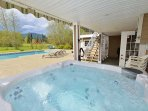 Hot tub with pool and mountain views