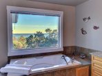A large tub with views to soak up the view.