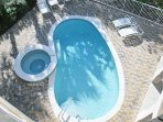 Kidney Shaped Pool With Many Loungers