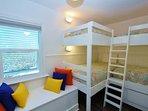 Bunk Bedroom Has a Bench