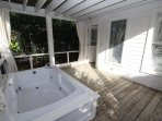 Porch has Privacy Curtains for Hot Tub