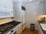 Kitchen has Sub-Zero Fridge and Ample Cabinetry