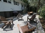 Adirondack Seating and Grill in the Back Yard