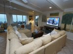 Living Room With Large Sectional - 65 Inch LED TV