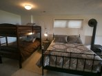Queen bed and Twin bunkbeds with gas fireplace