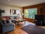 Living room w lake views and flat screen TV