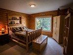 2nd bedroom w log furnishings