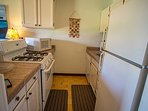 Kitchen with four burner gas stove and microwave