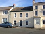 Two reception rooms and a kitchen on the ground floor, with bedrooms and bathroom upstairs.