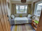 This little room on the ground floor can be used as a sitting room or bedroom with its cute day-bed