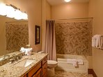 Main living level master bath with dual sinks