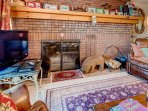 Fireplace,Hearth,Chair,Furniture,Bookcase