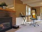 The downstairs master suite features a gas fireplace for added comfort and a digital piano