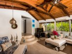 Main spacious bright living area. Ceiling fans to circulate the Caribbean breeze.