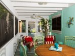 Screened sun porch. Dining area for 4