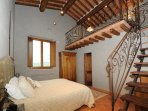 CORTONA Bedroom with Loft and Wrought Iron Railing
