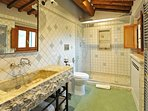 ORVIETO Ensuite Bathroom with 2 Waterfall Showerheads, Hand-carved Travertine Sink and Toilet/Bidet