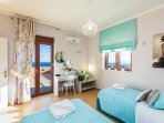 Bedroom with two single beds , A/C & sea view, (Beds can be set up as 1 double)