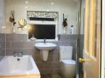 Brand new bathroom with large luxery shower and heated towel rail