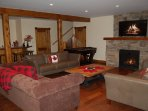 The Minks: Downstairs is large living room with 2nd gas fireplace, fooseball table, and bar area.