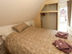 Kingsize memory bed, wardrobe ,chest of drawers, bedside lights, fan, DVD TV, sink