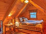 The loft offers another queen-sized bed.