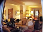 L shaped lounge, pool table, plenty of comfy furniture for everyone to relax. Wood burning stove.