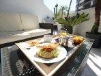 Have breakfast in our sunny balcony