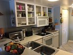 Fully stocked kitchen with all major and small appliances including crock pot, blender, coffee maker