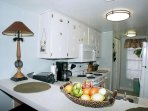 Kitchen has pantry for extra storage, utensils, pots & pans, baking pans, platters, small appliances