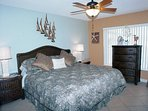 King size pillow top bed in Master suite with 32' flat screen TV, DVD , large closet, and dressers