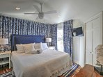 The second bedroom offers a king-sized bed.