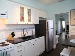Fully equipped kitchen with full sized refrigerator, range, microwave, pots, pans, utensils