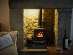 Cosy fire with logs and coal ready for you on arrival.