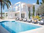 beautiful facade of modern villa and pool area