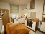 Kitchen on Ground Floor - well equipped with amenities. Access to Lower Ground Floor.