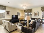 Spacious living area with 60\' TV; just one of many gathering places in home