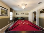 Media Room with pool table, card table, and wall mounted TV