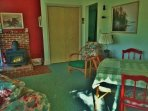 The eating area and wood stove in the great room at Paradise Cottage