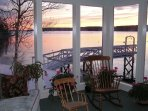 A snowy winter sunset from the Seanook sunroom, relaxation at its best