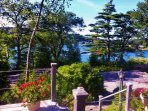 Down the front steps toward the cove from Paradise Cottage in the best of summer