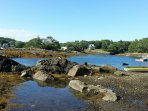 Low tide on the beach with the kayaks & rowboat, and Columbus Rock