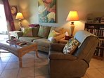 Living room has queen sleeper plus TWO recliners, movie and book library, 42' Cable TV, DVD, games