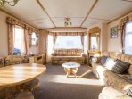 Lounge area hire this caravan for your family holiday.