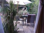 Double unit:  View from inside on to the private patio and garden.  Meals to served here if prefered