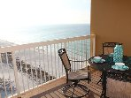 Unit 1712 features large dine-on balcony, with dining table and amazing views