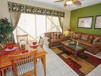Open Floor Plan featuring Kitchen Area, Dining Area & Living Room w/Pool Access