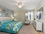 luxury vacation rental homes in orlando florida with master bedroom and TV