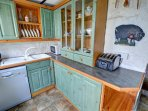 The kitchen is quite small but well fitted and with plenty of character