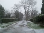 the road that leads to the house-in snow